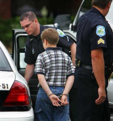 Photo of 10-year-old in handcuffs